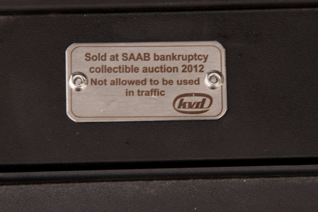 The metal placque placed under the hood of all MY12 cars in the auction.